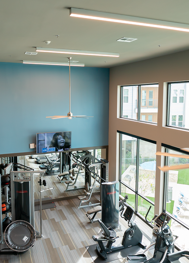 the view of fort worth two story fitness center with linear led lighting